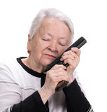 Old woman with pistol. On a white background Stock Photos
