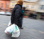 Old woman with plastic bags Royalty Free Stock Image