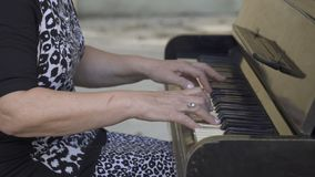 Old woman playing the piano stock video footage