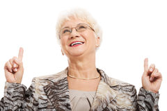 An old woman pointing up with fingers. Royalty Free Stock Photo