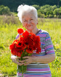 Old woman with poppies Royalty Free Stock Images