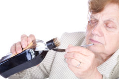 The old woman pours a liquid Royalty Free Stock Image
