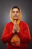 Old woman praying Stock Photos