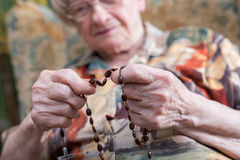 Old woman praying Royalty Free Stock Photo
