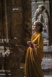 The old woman is praying in a temple Stock Photo