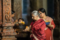 The old woman is praying in a temple Royalty Free Stock Images