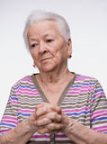 Old woman praying Royalty Free Stock Images