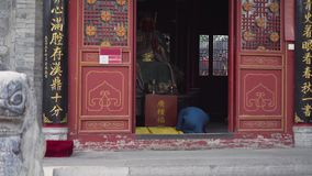 Old woman praying worship buddhist god. Xi`an Wolon Temple. China. Travel Asia stock footage