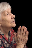 Old woman prays Royalty Free Stock Photo