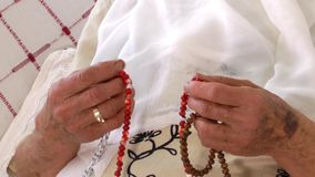 Old Woman Prays with Rosary stock footage