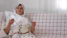 Old Woman Prays with Rosary Royalty Free Stock Image