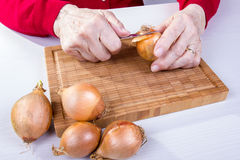 Old Woman prepares onions Royalty Free Stock Photo