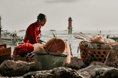 Old Woman When Preparing Goods before Across the Badung Strait stock photography