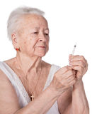 Old  woman preparing syringe for making insulin injection Royalty Free Stock Photos