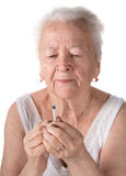 Old  woman preparing syringe for making insulin injection Royalty Free Stock Images