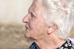 Old woman profile portrait stock photography