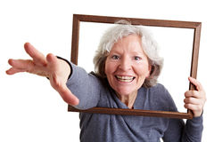 Old woman reaching through frame Royalty Free Stock Photos