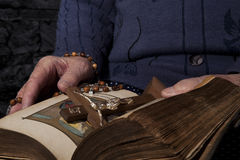 Old woman reading bible. Grandma with rosary and cross reading bible. Faith and religion Stock Photo