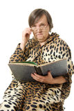 The old woman is reading a book Stock Photo