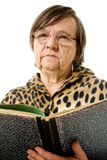 The old woman is reading a book Royalty Free Stock Photos