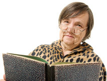 The old woman is reading a book Royalty Free Stock Image