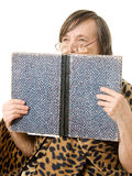 The old woman is reading a book Stock Image