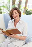 Old woman reading her book. During the summer stock images