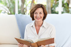 Old woman reading her book Royalty Free Stock Photo