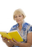 Old woman reading Stock Image