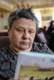 Woman reading magazine Royalty Free Stock Photo