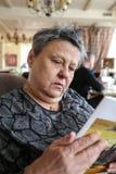 Woman reading magazine Stock Photography