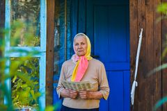 The old woman is reading the newspaper. stock image