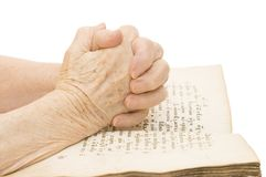 The old woman reads the bible Stock Image