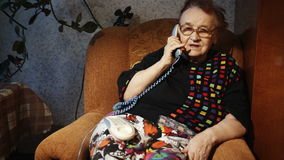 Old woman receiving a phone call in the evening stock video footage