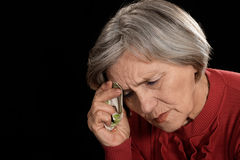 Old woman in red Stock Photos