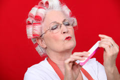 Old woman in rollers Stock Photography