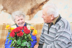 Old woman with roses royalty free stock photography