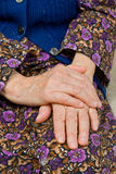 Old woman's hands. Old lady staying alone at home whit holding hands Stock Images