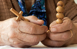 Old woman's hands holding rosary Royalty Free Stock Images