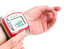 Old woman's hands measuring blood pressure Royalty Free Stock Photos