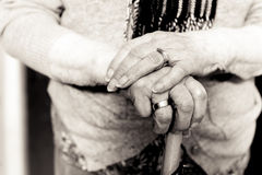 Old woman`s hands on umbrella handle. Black and white. Royalty Free Stock Image