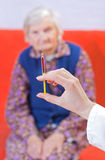 Old woman's injection. The doctor gives old woman's an injection Royalty Free Stock Photography