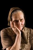 Old woman in sadness Stock Images