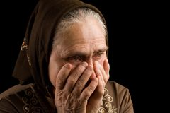 Old woman in sadness Stock Photo