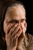 Old woman in sadness. Portrait of an old woman in thoughts Stock Photography