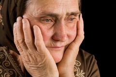 Old woman in sadness Royalty Free Stock Photo