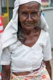 Old woman with sari. Old Sri Lankan Woman with sari and head scarf Stock Image