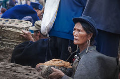 An old woman selling chicken Stock Images