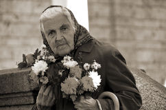 Old woman selling flowers Royalty Free Stock Image