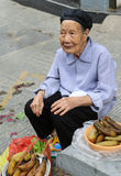 The old woman selling pickles in zhenyuan ancient town,guizhou,china Stock Photography